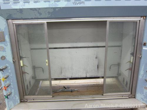 "Used- St Charles Manufacturing Laboratory Fume Hood. Internal dimensions approximate 62-1/2"" wide x 23-1/4"" deep. Sliding fr..."