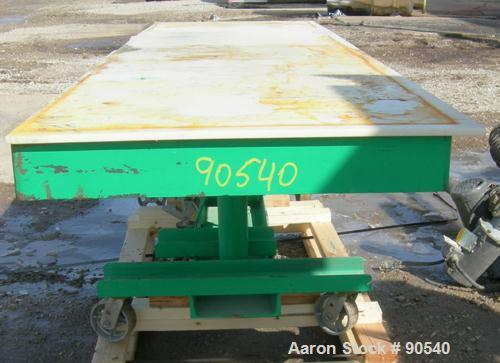 "Used: Lexco long deck hydraulic lift table, model STN3010-2F, carbon steel. Approximately 2000 pound lift capacity, 30"" wide..."
