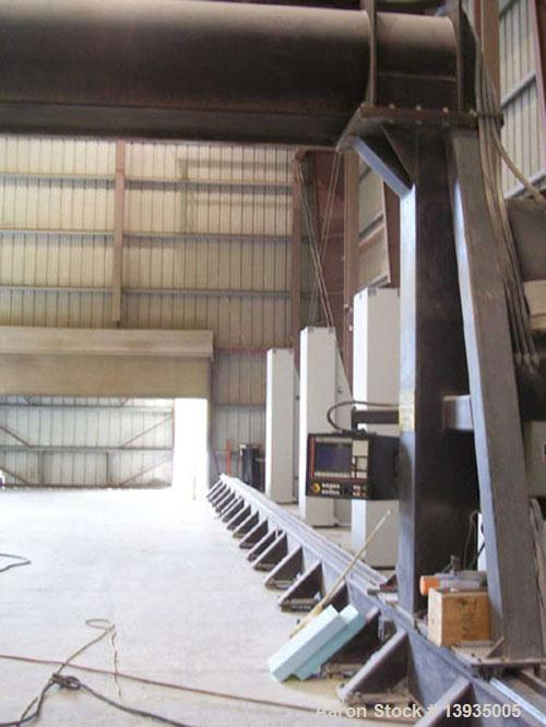Used-Motionmaster 5 axis CNC router. Track system: X axis travel 65', Y axis travel 19', Z axis travel 10'; one spindle, 7 h...