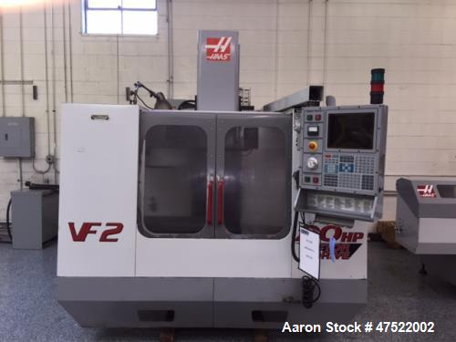 "Used- Haas VF-2 CNC Vertical Machining Center. Haas control, 36""x 14"" table size, 3,000 pound table load. 30"" X-axis travel,..."