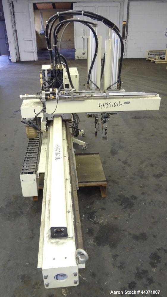 Used- Yushin America Airliner AE-200D Robot. With a servo traverse and two pneumatic axes. Includes a model AN-3500 portable...