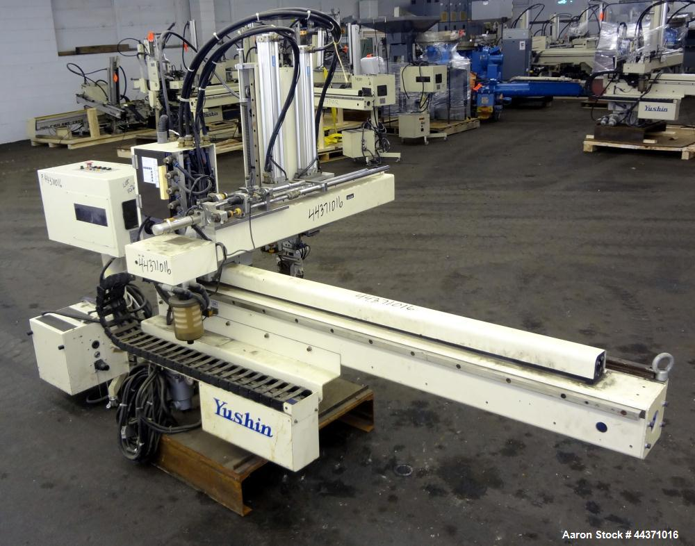Used- Yushin America Airliner AE-200D Robot. With a servo traverse and two pneumatic axes. Includes a model YC-3000 portable...