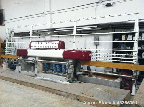 Used-Glass Edging Machine, Model DJ252, 9 spindle.  Can polish flat edges with a 45 deg aris or produce a miter up to 60 deg...