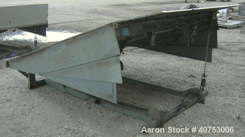 "Used- Serco Mechanical Dock Leveler, model W8730, carbon steel. 83"" wide x 81"" long plate with a lip extension. Approximate ..."