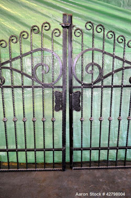 "Used- Wrought Iron Gates.  Set Consisting Of: (2) Gates, each approximate 80"" wide x 84"" tall."