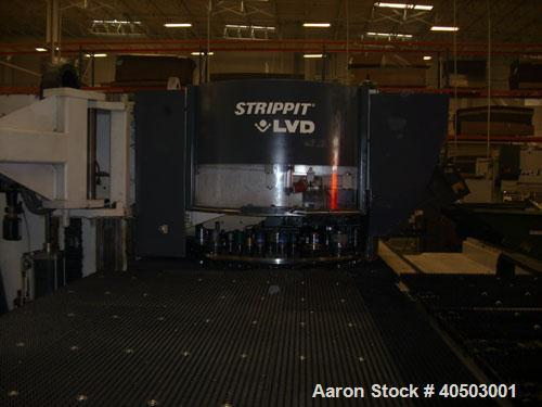 Used-Omega Series 30 ton fabricating center (punch press). Comes with an automatic material handling system. Two table sizes...