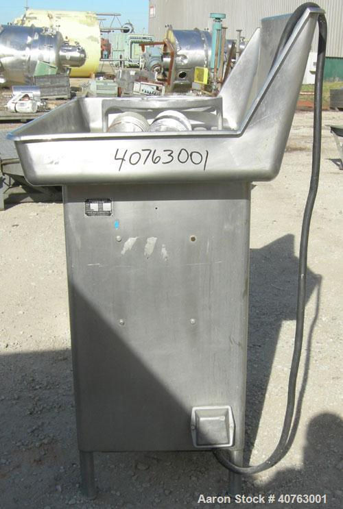 "Used- Butcher Boy Meat Grinder, Model A56.HF, 304 stainless steel. Top tray 49 1/2"" wide x 27"" long x approximately 6"" deep...."