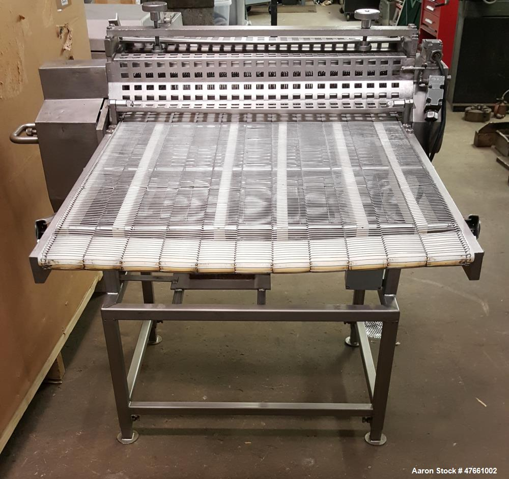 "Used- Formax Cuber-Perforator, Model MC.  27. 26"" Wide usable belt, 1.5 hp drive, 460V/3PH/60HZ, 1.5 Amps,  scores portions ..."
