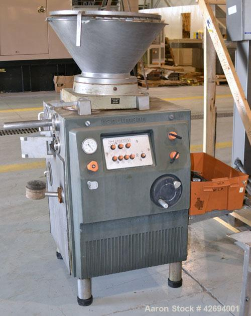 Used- Handtmann Vacuum Filler, Model VF10-50, Code 65/25, Carbon steel. Top feed hopper with mixing arm, driven by a 0.55kw,...