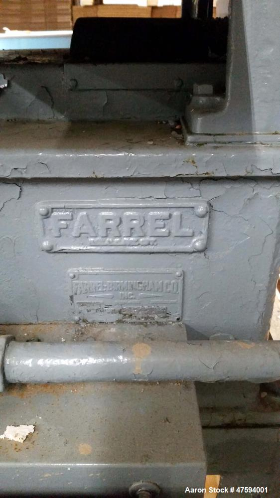 "Used- Farrel 2 Roll Mill. 6"" x 13"", cabinet style. Overall dimensions 53""long x 42"" wide x 96"" tall with hood. Includes: rot..."