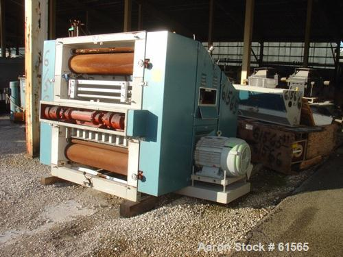 USED: Buhler Miag malt mill, type DBZA-12300X. Built 1989. 6 rollers,high capacity. Mill is totally enclosed with large door...
