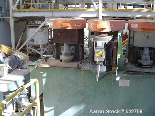 """USED: Quinn Process Equipment attrition scrubber. 4 Cell unit,24"""" x 24"""" ID tanks, 10' tall cell, 10 hp motor."""