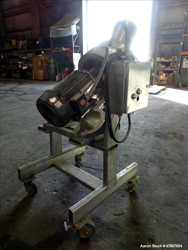 """Used- Angle Disintegrator, 304 Stainless Steel. Approximate 13-3/4"""" diameter x 3-3/4"""" deep grinding section, housing approxi..."""
