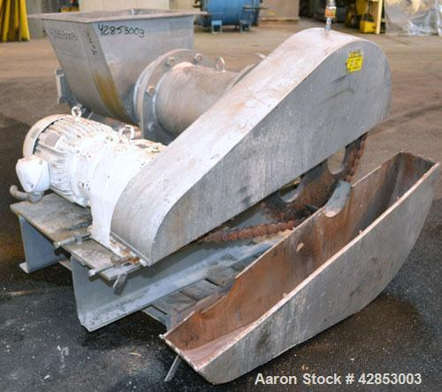 """Used- Rietz Bepex Extructor, Model RE-15-K7E328, 304 Stainless Steel. 14"""" Diameter blade. End orifice plate. 24'' x 22'' Top..."""