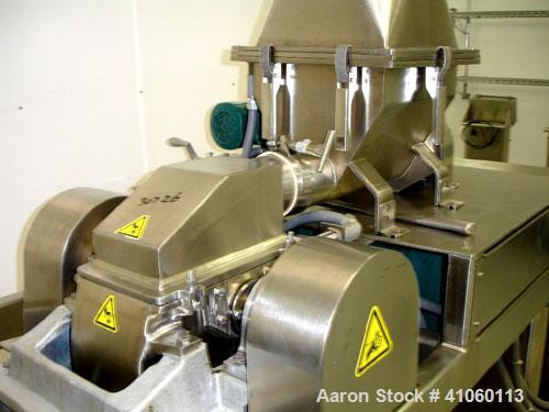 Used- Fitzpatrick Fitzmill, Model DASO6, stainless steel construction, fixed blades, reversible chamber, screw feed with mot...