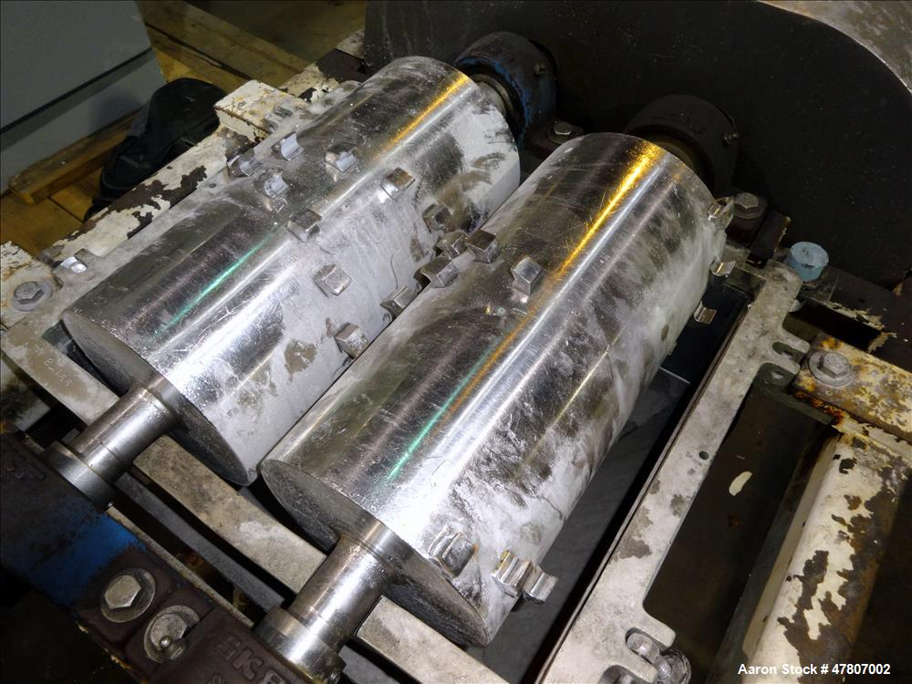 "Used- Fitzpatrick Twin Shaft GuiloRiver, 304 Stainless Steel. (2) Approximate 6-1/2"" diameter x 13"" wide rolls with riving p..."