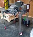 Used- Fitzpatrick Fitzmill, Model D6A. Stainless steel construction, cantilivered design with screw feeder with feed hopper,...