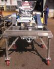 Used-Fitzpatrick Fitzmill, Model DAS012, Stainless Steel.  Drop feed, 20 hp motor, mounted on stainless steel base.