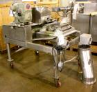 Used- Fitzpatrick Fitzmill, Model DKASO-12, Stainless Steel. Twin screw feed wtih 1 hp, 230/460 volt XP drive, less rotor, c...