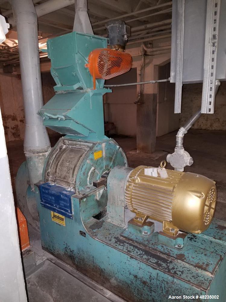 Used- Jacobson Hammer Mill, Model IT-24DF10. Includes: 50hp Baldor motor, feeder, magnet, breaker box. Base mounted with bot...