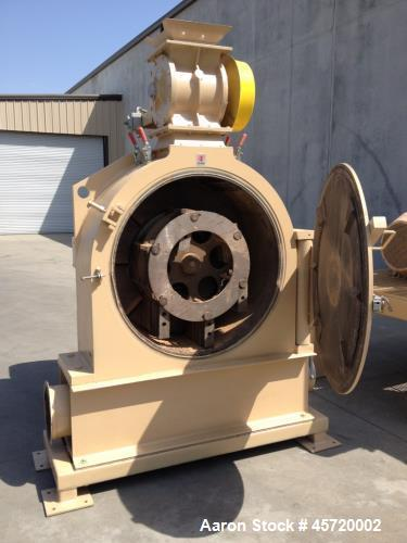 Used- Prater Model MM-18 Mega Mill. Unit has 150HP motor and has carbon steel contact. Hammer type: tool temp. Screen size: ...