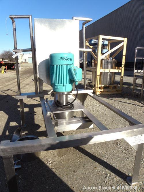 """Used- Quadro Comil, Model 196, 316 Stainless Steel. Approximate 12"""" diameter screen,  Approximate capacity up to 8000 pounds..."""