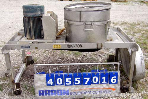 "Used- Quadro Comil, model 198S, 304 stainless steel. Approximate 24"" diameter x 12"" deep chamber with bar, no screen. Approx..."