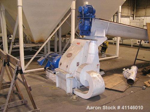"Used- Schutte Hammer Mill, Type F, Model 165. 60-75 hp capacity, includes an 18"" fan, 4000 cfm."