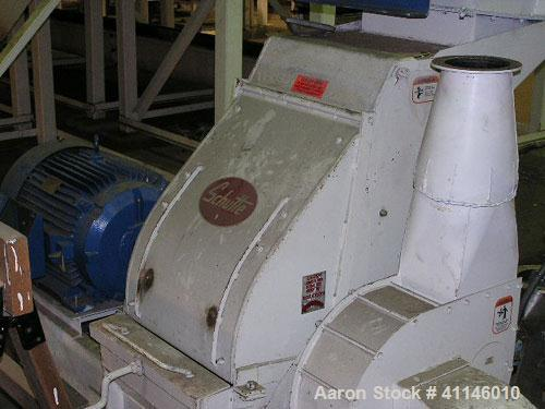 "Used- Schutte Hammer Mill, Type F, Model 165. 60-75 hp capacity, includes an 18"" fan, 4000 cfm."