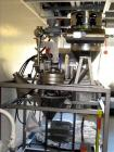Used- Kemutec Kek Pin Mill System, Model 5H. Driven by a 5 hp, 230/460 volt motor. With rotary feeder, dust filter, and disc...