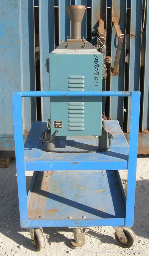 "Used- Thomas Wiley Cutting Mill, Model 4, Carbon Steel. 141 cubic inch chamber, 7-3/4"" diameter x 3"" deep. 4 bolt on blade r..."