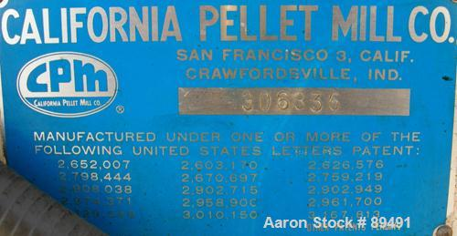 """USED: California Pellet Mill, Model Master, Carbon Steel.  Approximate 14"""" diameter die with (2) rollers, adjustable side bl..."""