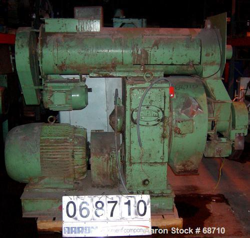 "USED- California Pellet Mill, Model 2000, Carbon Steel. 2 approximate 7"" diameter rollers, 16"" diameter x 10"" deep cutting c..."