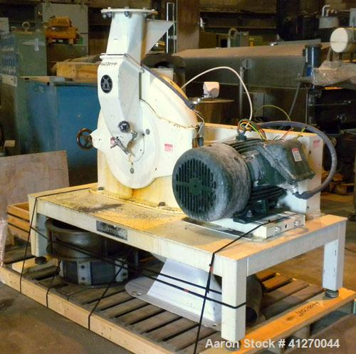 """Used- Bauermeister Universal Mill, Model UT22, Carbon Steel. Approximately 18-1/2"""" diameter x  6"""" deep sieve ring assembly, ..."""