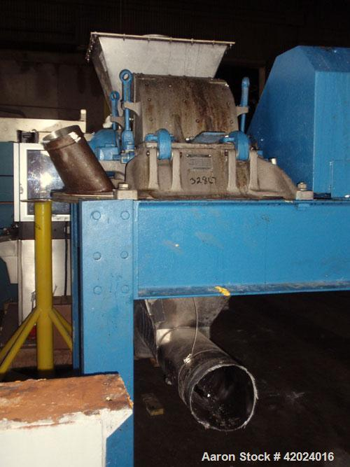 Used- Micron Powder System Pulverizer, Model 4TH, stainless steel. Triple horizontal screw feeder with hopper. Pulverizer dr...