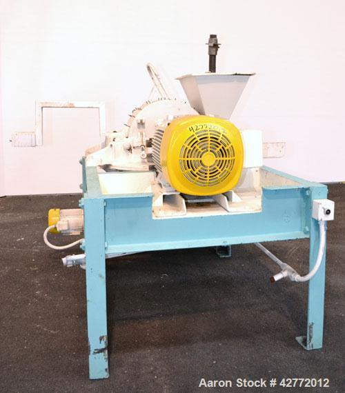 """Used- Mikro Pulverizer Hammer Mill, Model 4TH, Carbon Steel. 20"""" Diameter x 12"""" wide rotor with 4 rows swinging stirrup hamm..."""