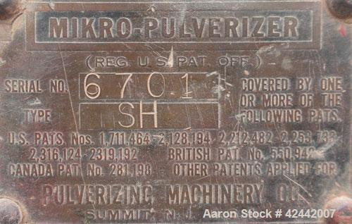 "Used- Mikro Pulverizer Hammer Mill, model 1SH, carbon steel. Approximate 8"" diameter x 3-1/2"" deep chamber with (6) 3'' wide..."