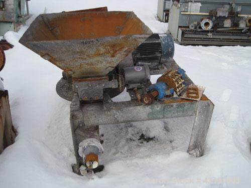 Used- Mikro Pulverizer, Model 2DH, Carbon Steel. Rotor with (2) rows of swinging hammers. Dual screw feed driven by a 3/4 hp...