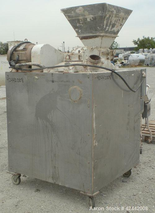 "Used- Mikro Pulverizer Hammer Mill, model 2SI, carbon steel. Approximate 12"" diameter x 6-1/2"" deep chamber with (2) rows of..."