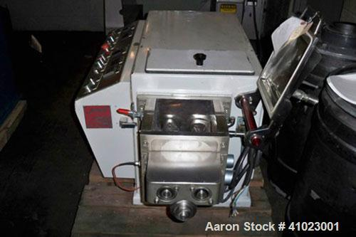 Used-Jaygo Baker Perkins Model AME-7 Double Arm Sigma Mixer Extruder. Manufactured 1997. Unit features approximately 2 gallo...