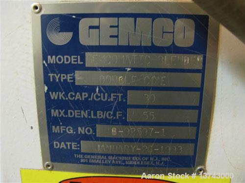 Used-Gemco 30 cubic foot Gemcomatic double cone blender. Complete with loader and unloader. Has liquid/solid intensifier bar...