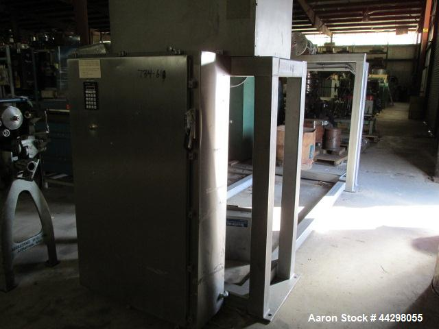 Used- Custom Metalcraft Transtore Tote Bin Blender, Model 710321, stainless steel frame and tote rack, twin post mounted, se...