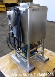 Used- Norman Likwifier, 304 Stainless Steel, Approximate 17.5 Gallon, Vertical.