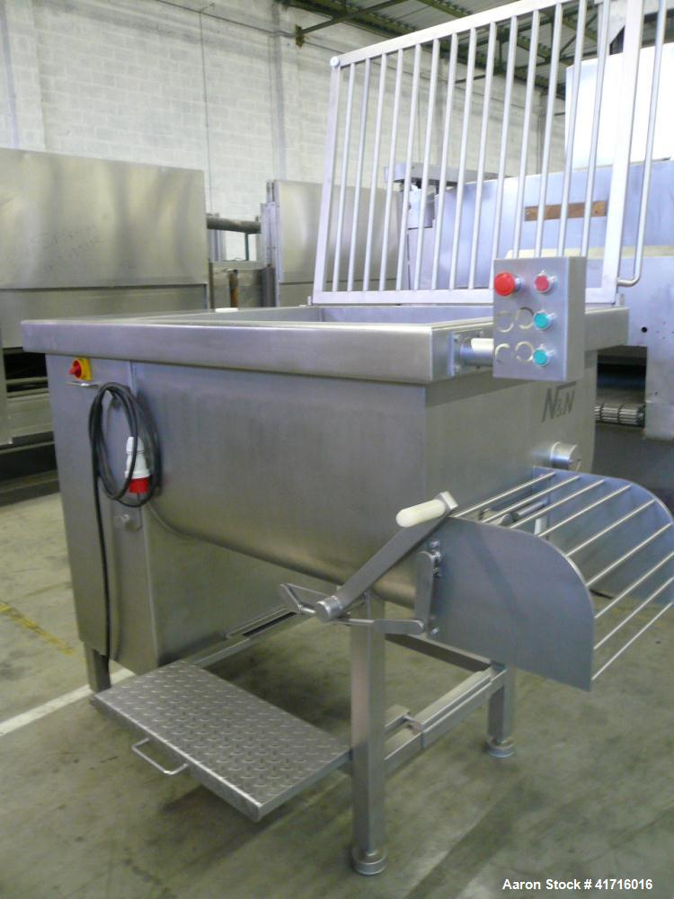 Used- N&N Twin Shaft Paddle Mixer.  Stainless steel contact parts, 2 mixing directions, inspection gantry, CE approved.  Dim...