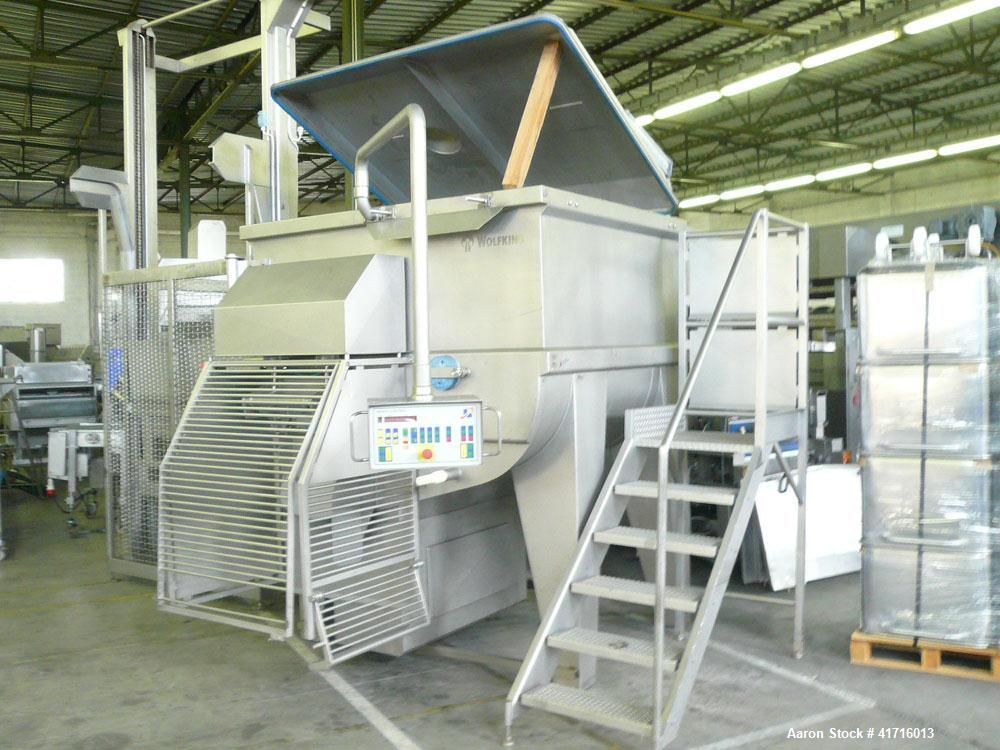 Used-Wolfking Twin Shaft Paddle Mixer with built-in discharge pump.  Maximum capacity 97 cubic feet (2750 liters).  Unit dim...