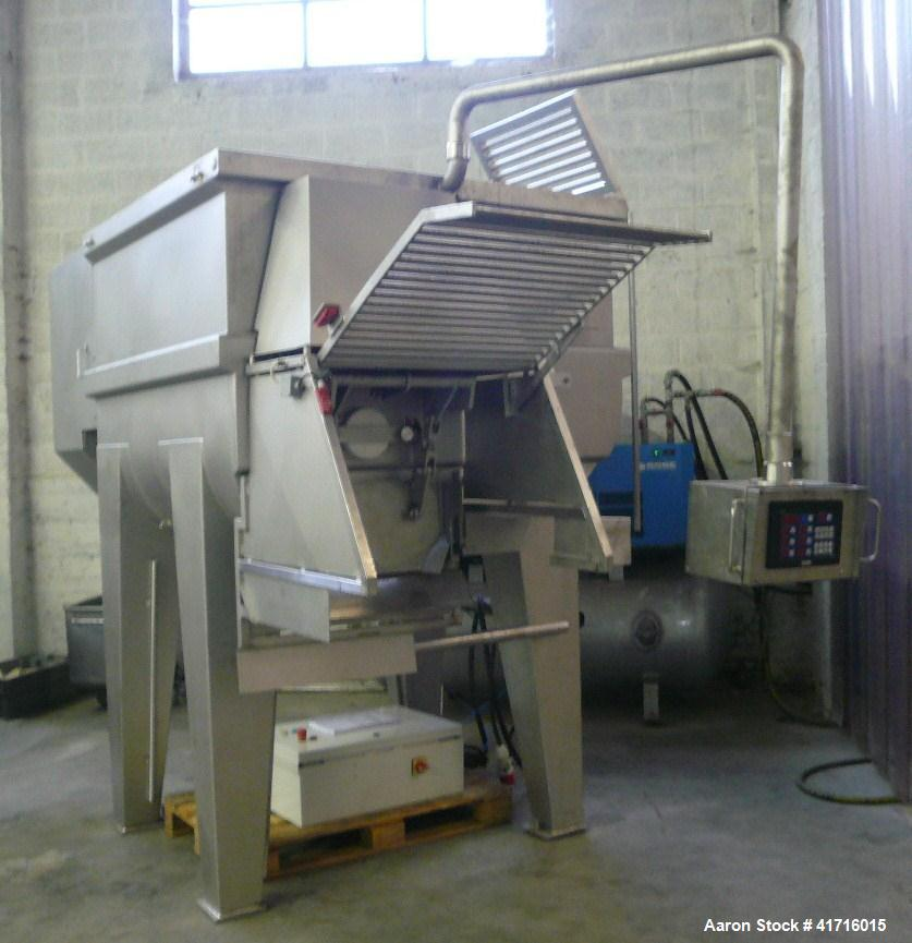 Used- Stainless Steel Wolfking Twin Shaft Paddle Mixer.  Maximum capacity 61.8 cubic feet