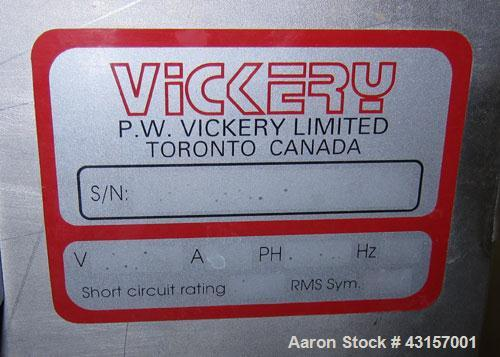 Used-Vickery Ribbon Blender, Approximately 5 cuft.  Stainless steel. Center bottom discharge.  3 hp, 330/ 575 volt.