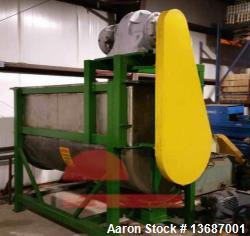 100 Cubic Foot Stainless Steel Ribbon Mixer. 20 hp drive motor. Unit reported to be reconditioned.