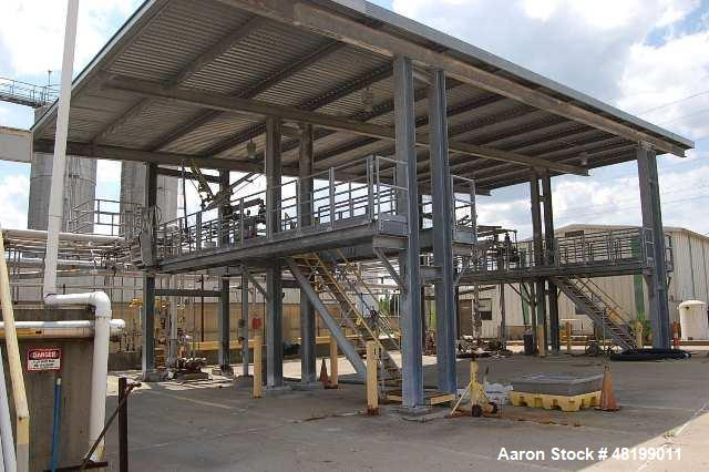 Used- Tanker Truck Safety Loading Station. (4) Truck bays. Approximate 40' x 80' with roof.