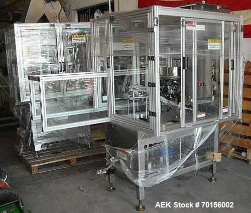 Used-Haumiller 3200 Series Tip Inserter capable of speeds up to 180 cans per minute. This is a 6 pocket continuous motion ma...